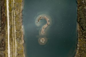 island in the shape of a question mark