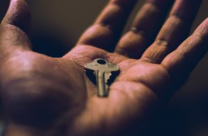 key in the palm of a hand